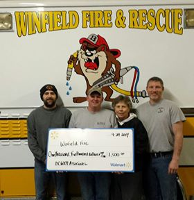 Winfield, Iowa fire department was a recipient of the Walmart Foundation Community Grant.  Pictured are Matt Nelson, Josh Sparrow, DC 6009 associate Patti Gerling and Chad Venghaus.